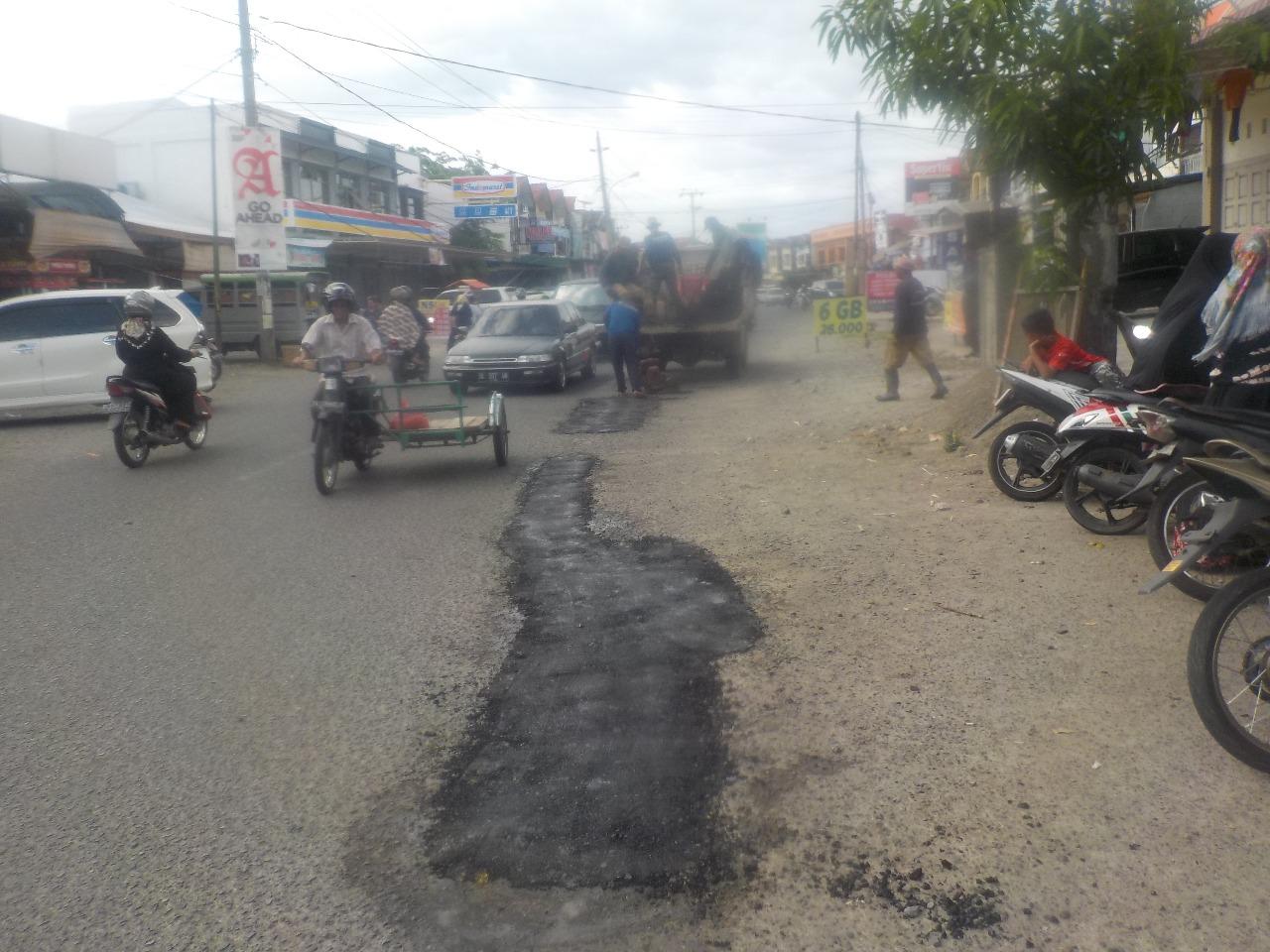Patching Jalan Neusu 6